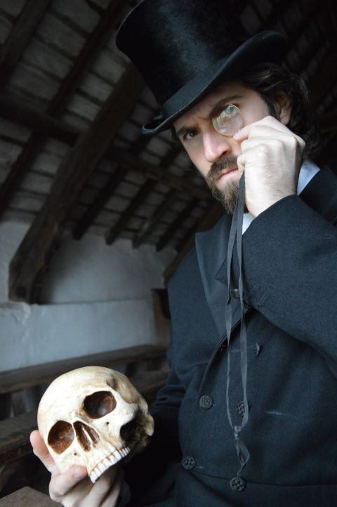 Picture of a man holding a skull