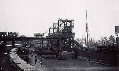 No.1 dock in 1913, when Barry docks exported 11m. tons of coal. What appears to be a solid level surface in the right foreground of this scene in is fact dock water coated with scum and coal dust.