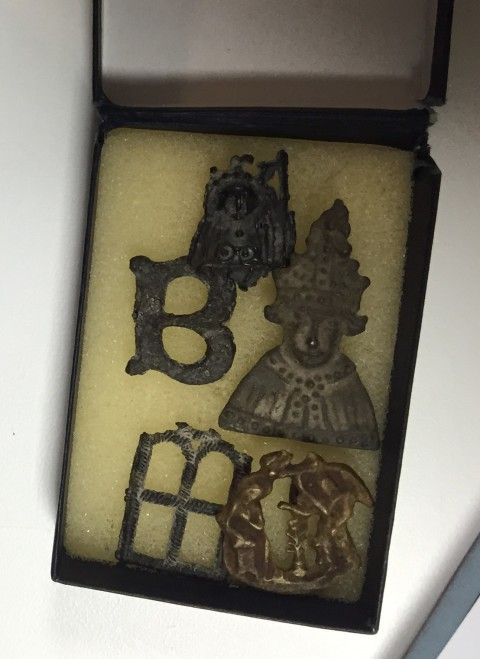 A small box containing a small number of medieval pilgrim badges