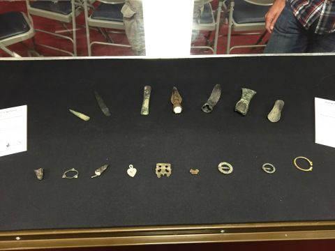An open display case with a selection of small finds laid out inside