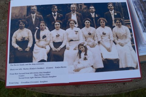 Album photo of the Davies family and shop assistants