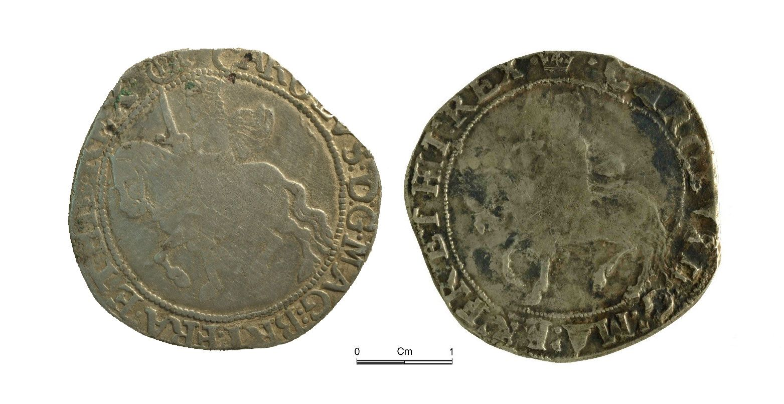 One of these Charles I half-crowns is also a fake. Can you tell which one?