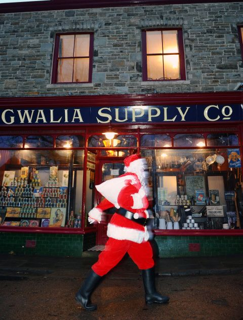Father Christmas walking past Gwalia Stores