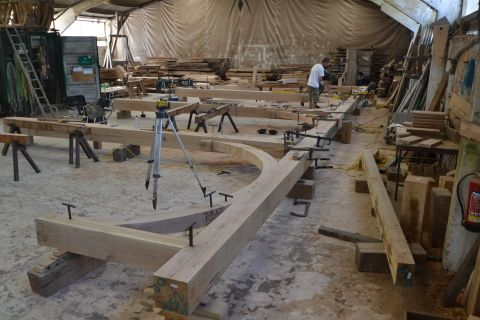 Image taken within the workshop showing the timber frame being assembled