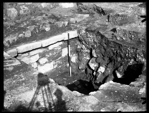 Black and white photograph of excavations