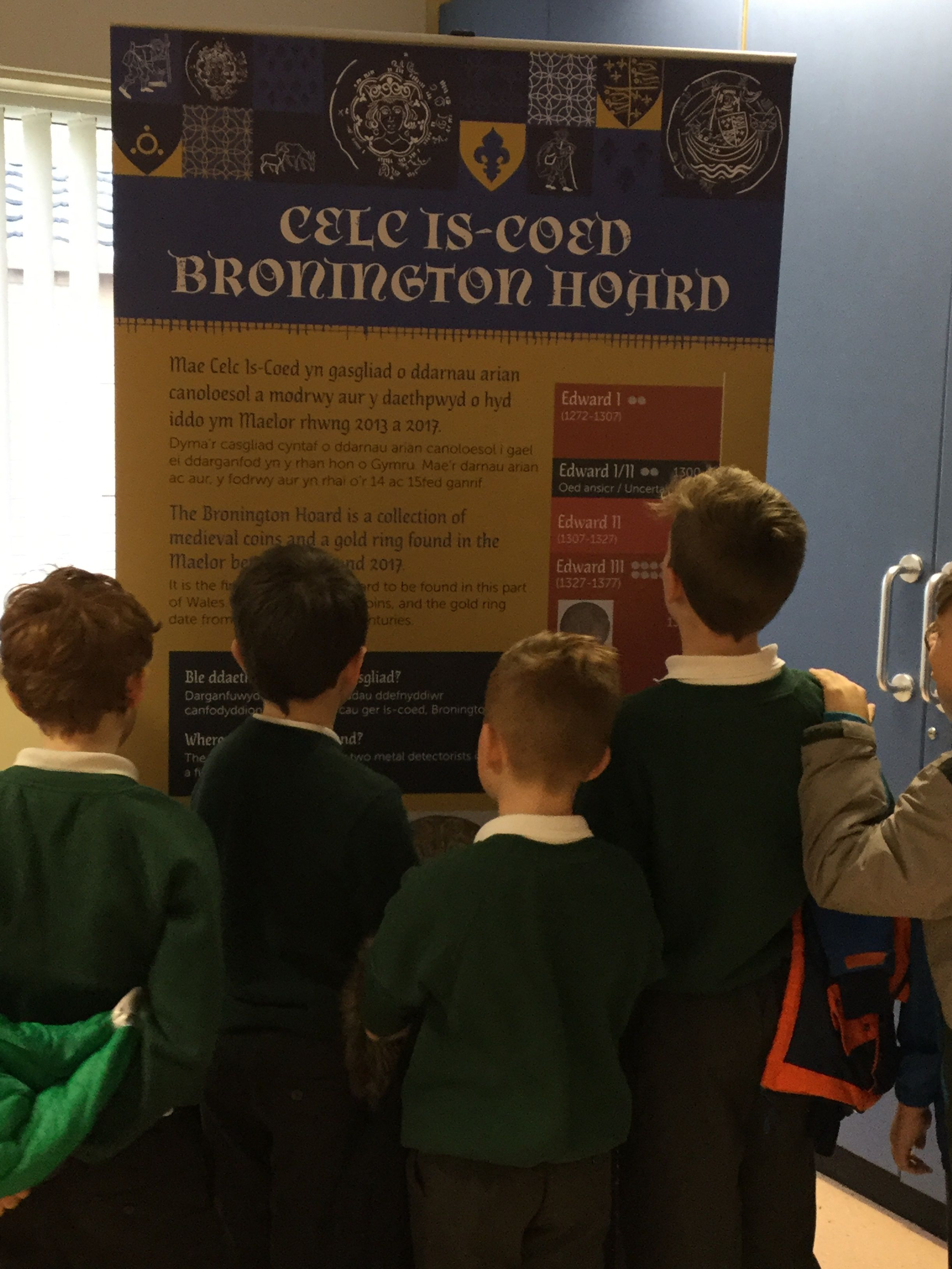 School children looking at an information panel on the Bronington Hoard