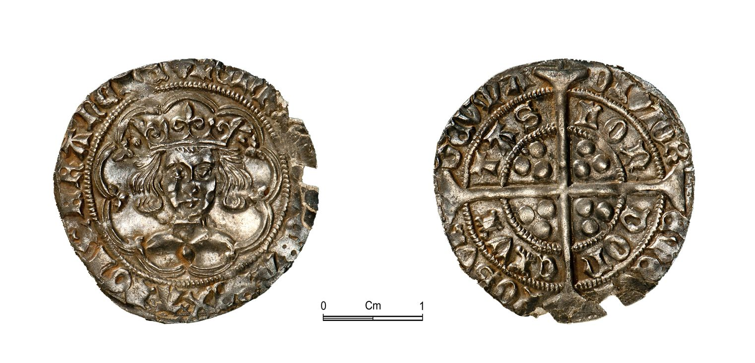 A picture of a detailed medieval silver coin, both sides shown
