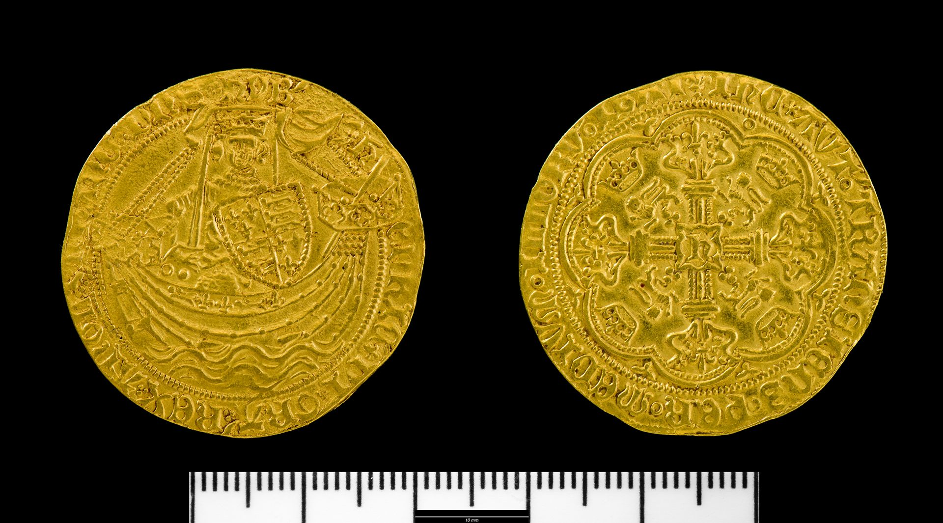 A picture of a detailed medieval gold coin, both sides shown with one side showing a detailed depiction of a ship