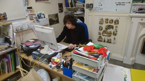 Student volunteer Tom working at his desk at Wrexham museum
