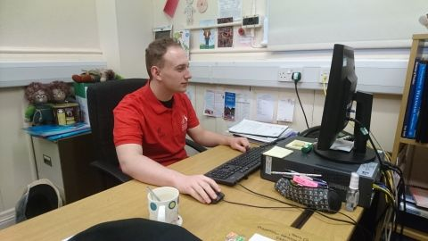 Student volunteer Leon working at his desk at Wrexham museum