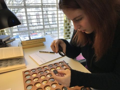 Eirini student work placement studying ancient coins