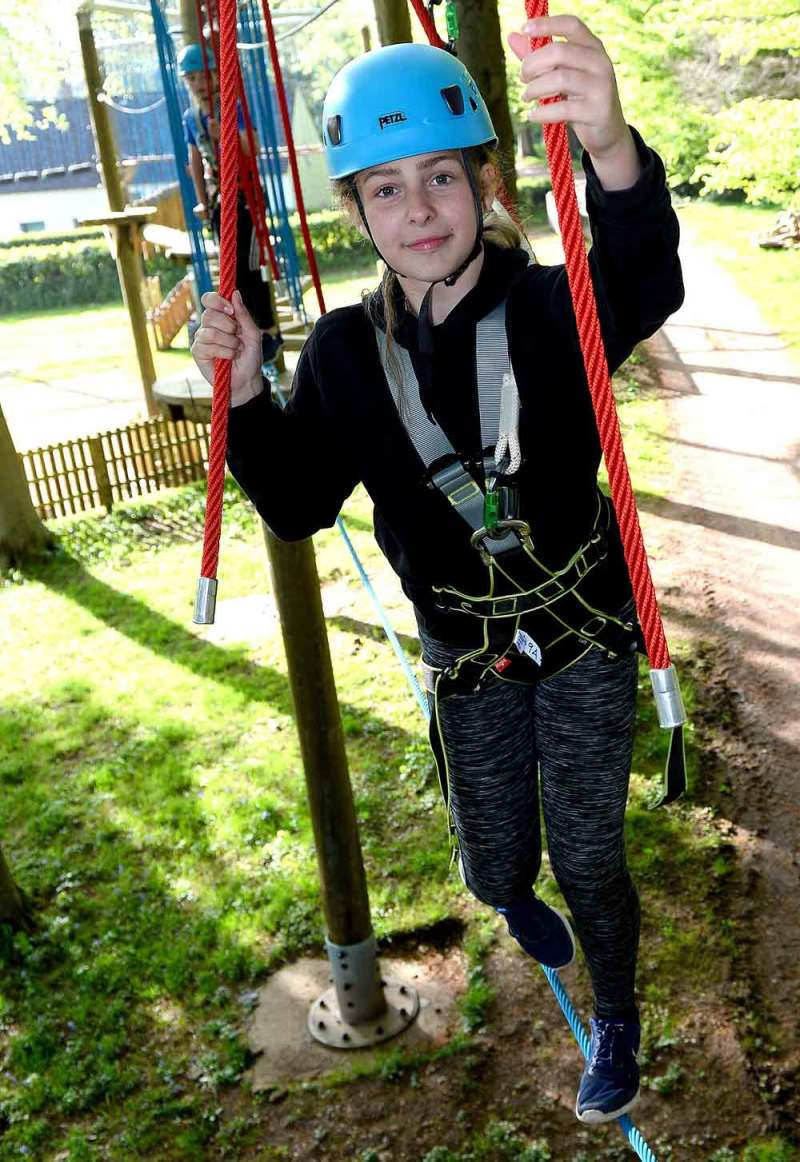 Girl on high ropes course at St Fagans