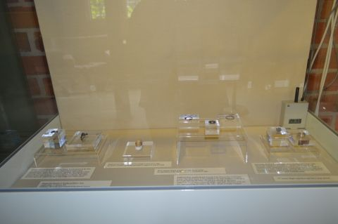 An image of some pieces of jewellery in a display case
