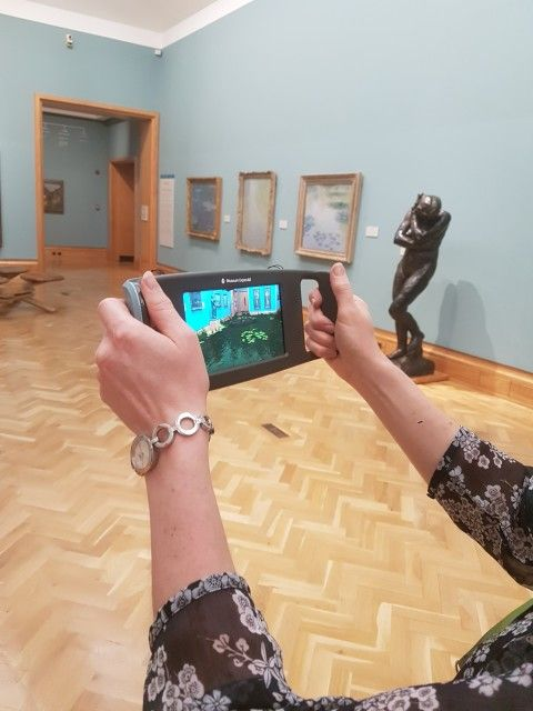 View of device in the gallery showing augmented reality on the screen