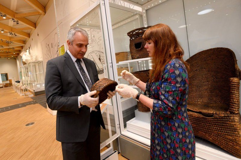 photo of HLF and ACNMW staff inspecting an object in a new gallery