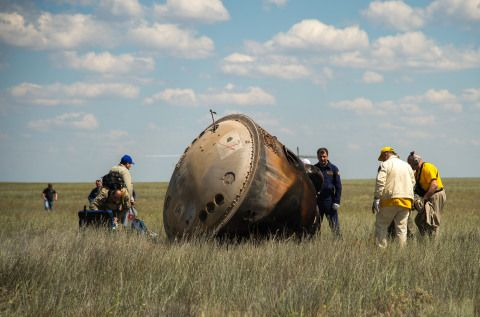 photo of space capsule after landing