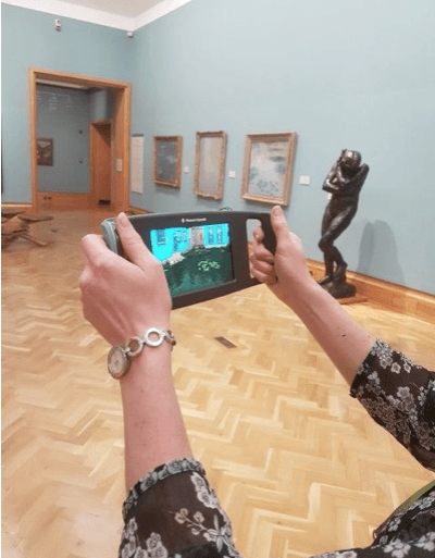 View of device in the Impressionist gallery showing augmented reality on the screen