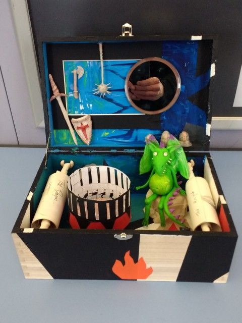 photo of a fantasy museum inside a shoebox, including an animation reel and clay dragon