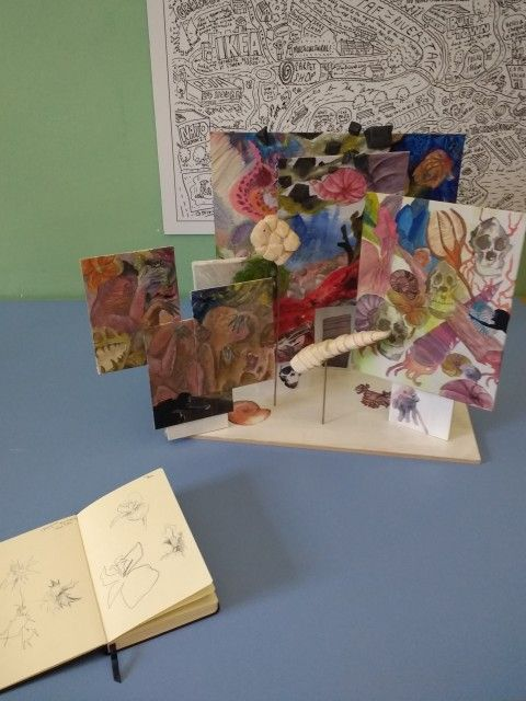 Photo of mixed media painting by a student, inspired by animal specimens in natural history galleries