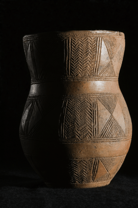 A bronze age 'beaker' pot showing typical geometric decoration.