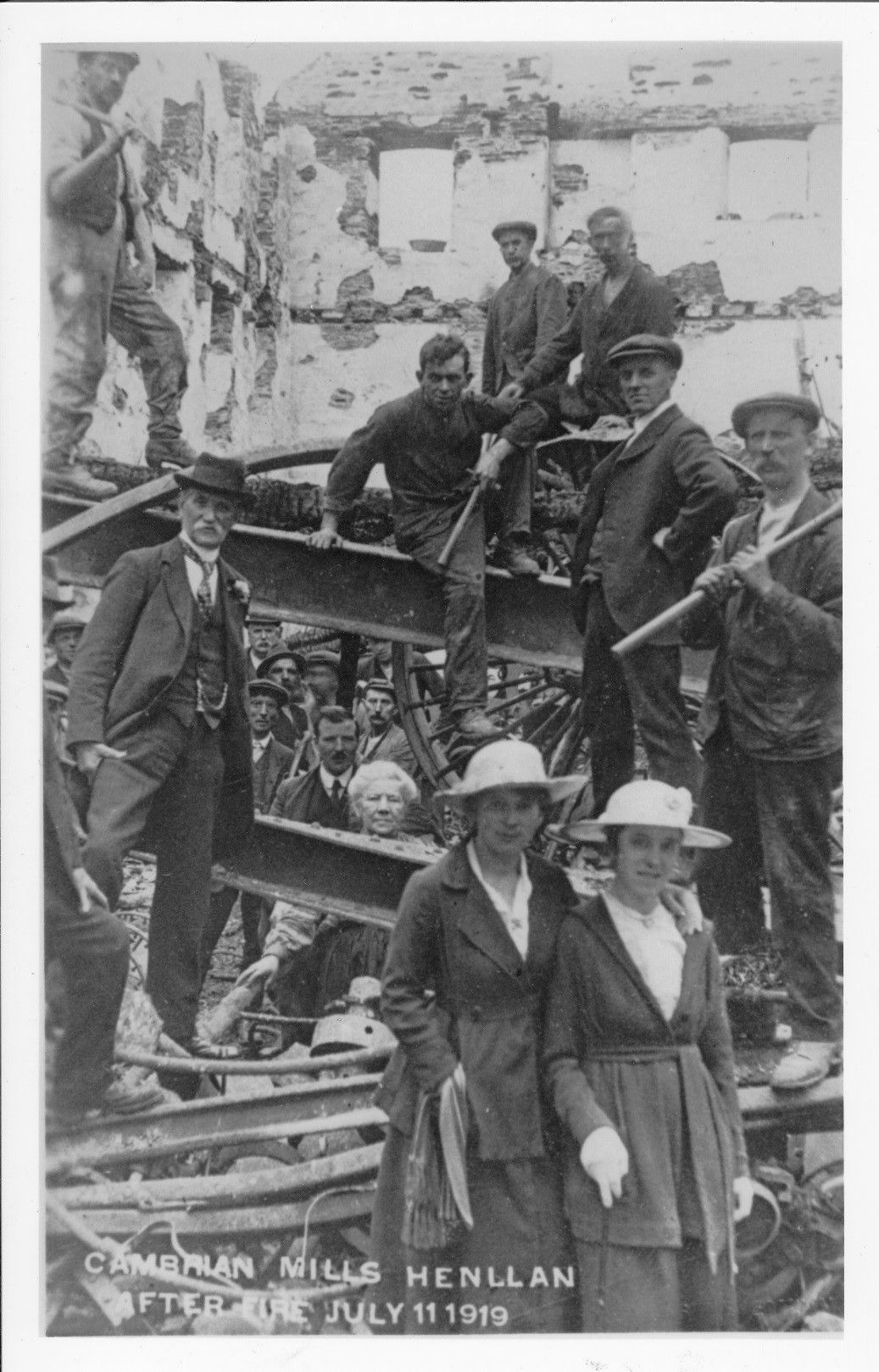 David Lewis on the left of the photograph with the moustache and hat in the remains of Cambrian Mills