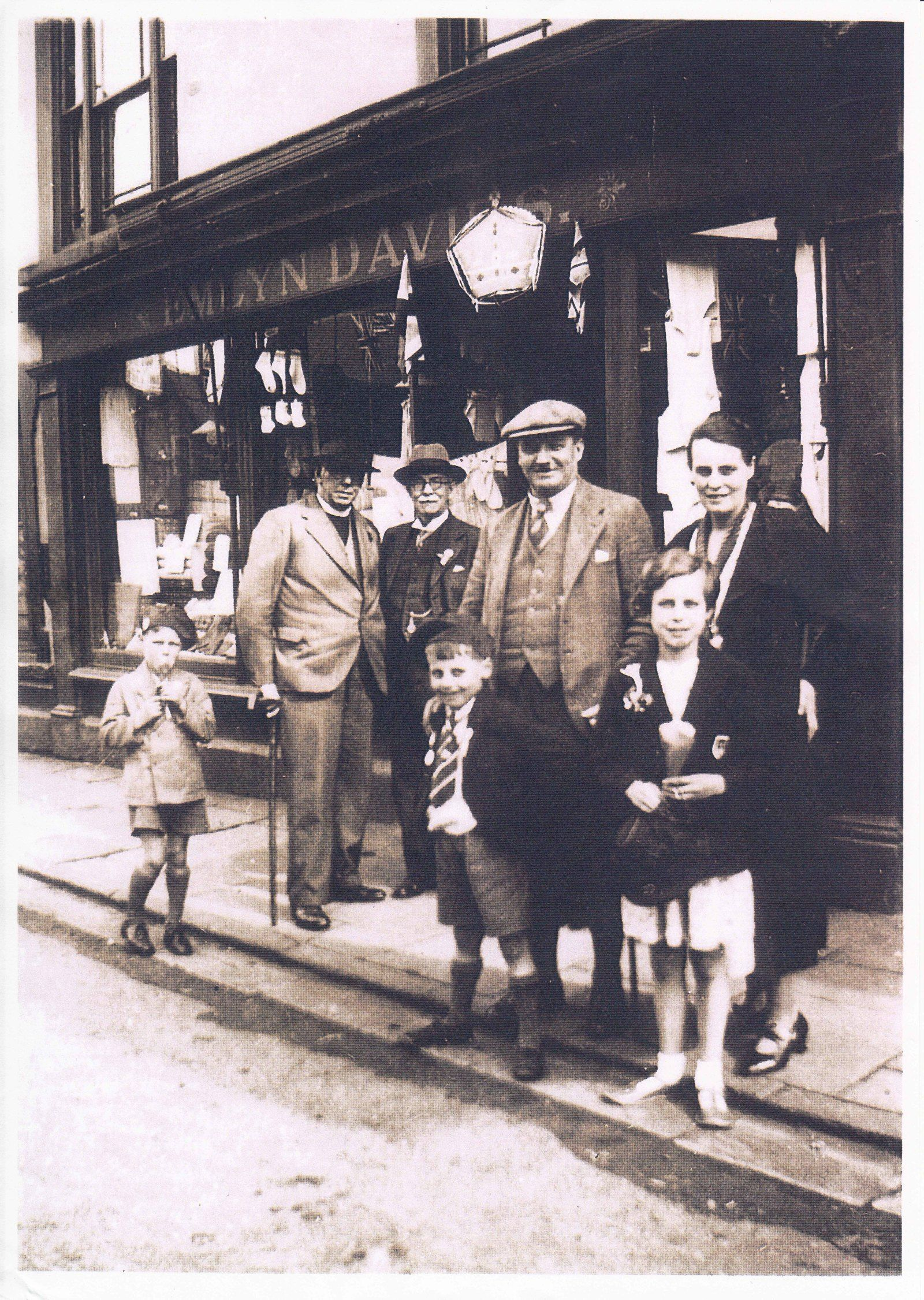 Emlyn Davies outside his shop with friends and family Coronation Day 12th May, 1937