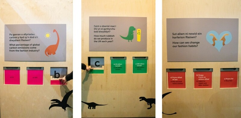 A photo fro the Dippy Abuot Nature Exhibition. It shows a quiz game in which visitors push down a wooden door to reveal answers.