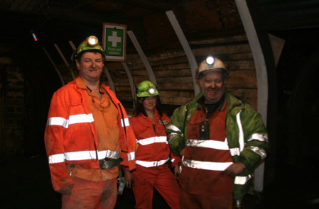 Underground photo with Katherine Voyle and 3 mineworkers at Aberpergwm Mine