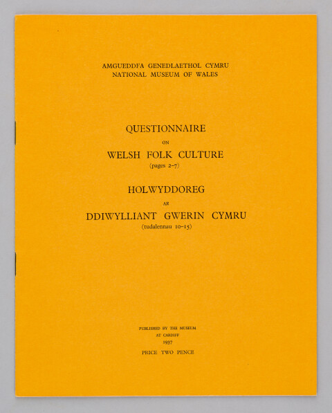 Mustard coloured front page of the Questionnaire on Folk Culture. Title printed in Welsh and English in black ink.
