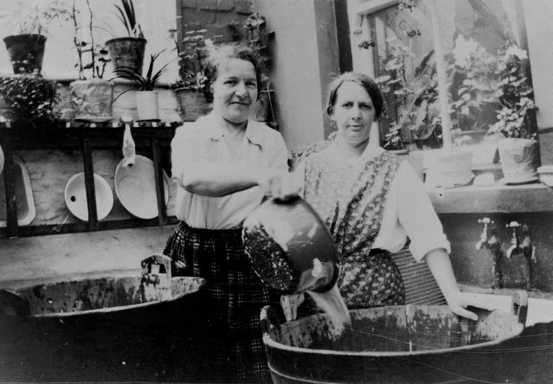 Mrs Margaret Rees and her sister on washing day, Abercynon, 1920s