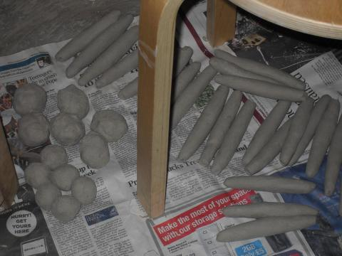 The clay rolled to form fingers and palms