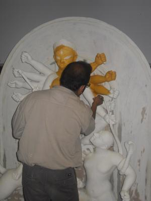 The artist Dibyendu Dey painting the Goddess Durga