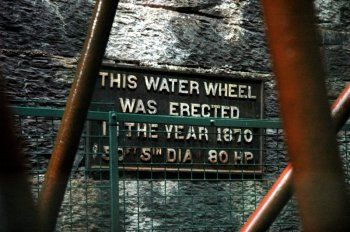Waterwheel plaque, by Art Patnaude