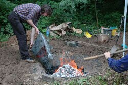 Adding charcoal to the furnace