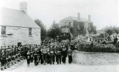 The Band of the Cardigan Volunteer Corps waiting at Cilgerran station to welcome Lt. Colby of Ffynnone home from the Boer War, <em>c.</em>1902