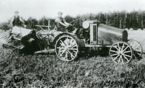 One of the first tractors and corn binders in the district in use at Castle Malgwyn Home Farm