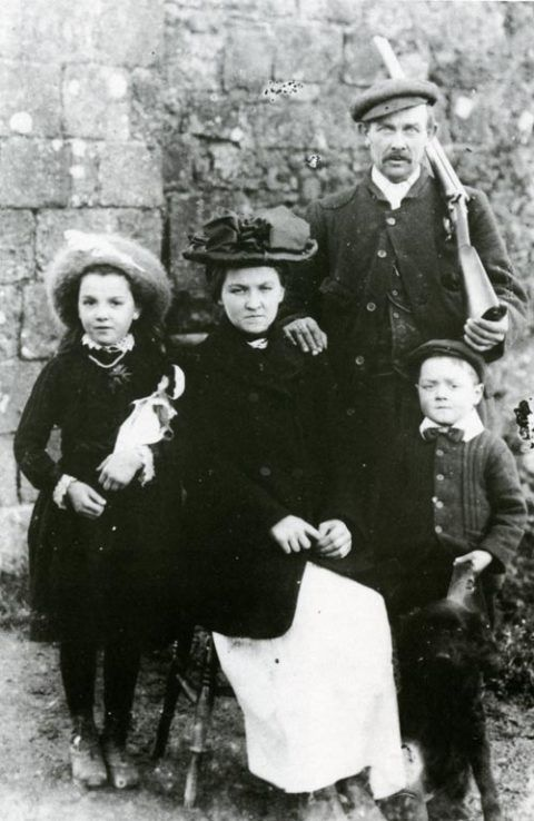 An unidentified gamekeeper with his family
